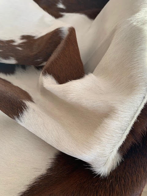A-1296 Brown and White Spotted Cowhide Rug Size: 7' X 6 3/4'