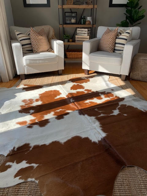 A-1365 Brown and White Spotted Cowhide Rug Size: 7' X 7'