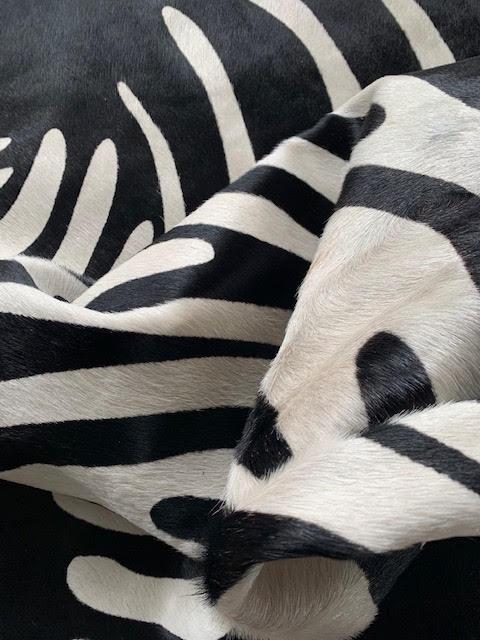 A-1426 Reverse Zebra Print Cowhide Rug Size: 6 1/2' X 6'